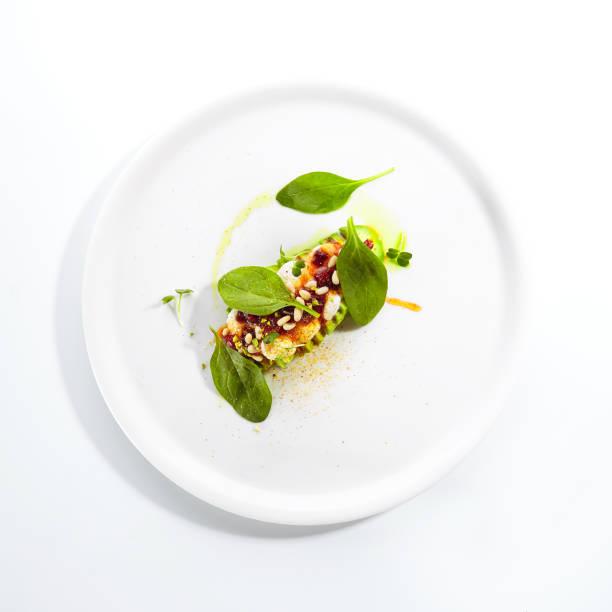 Avocado mit Mozzarella-Creme und getrockneter Tomatenmarmelade – Foto