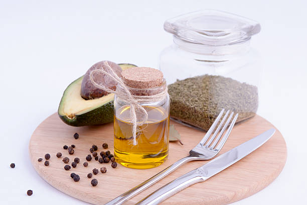 Avocado with olive oil stock photo