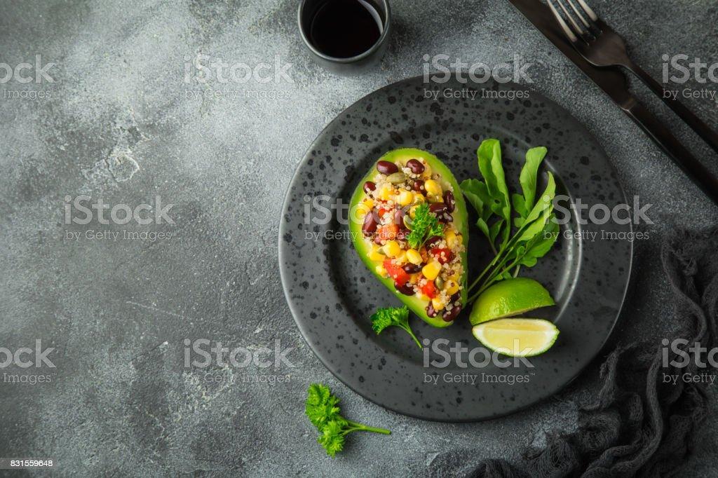 Avocado,quinoa,  black  bean, corn and bell pepper salad served in avocado stock photo