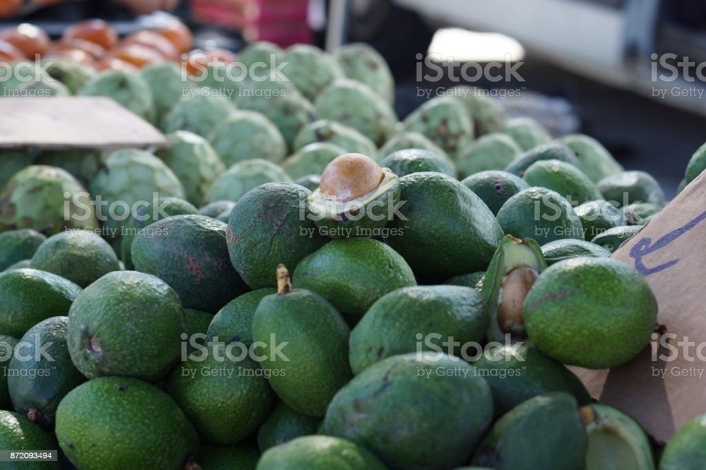 Avocados and artichokes are sold in the vegetable market in Spain stock photo