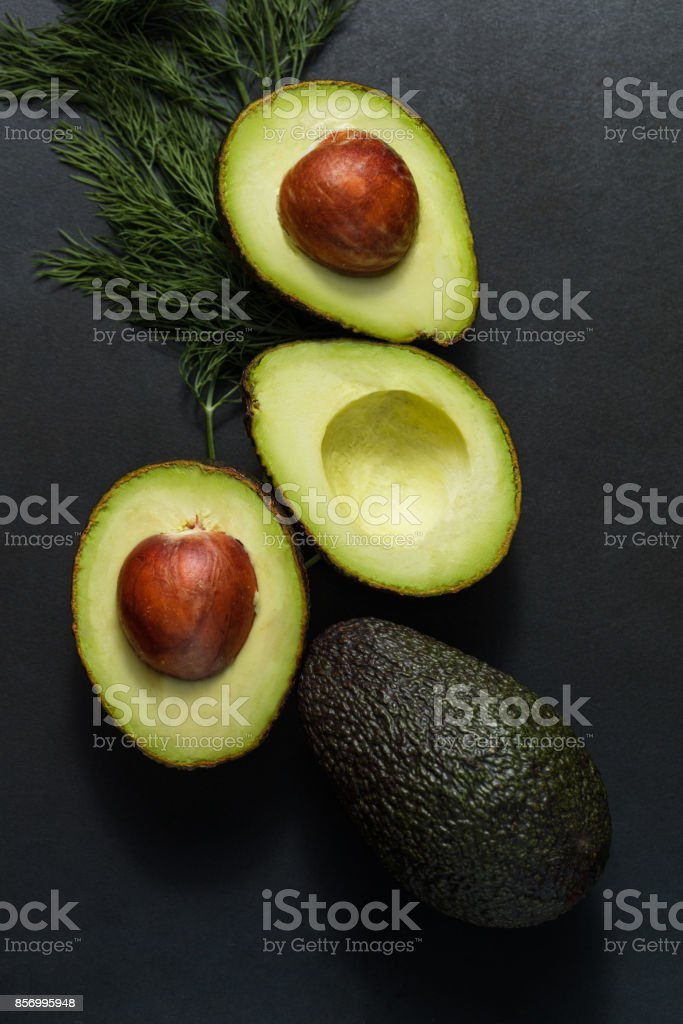 Avocados and dill leaves royalty-free stock photo
