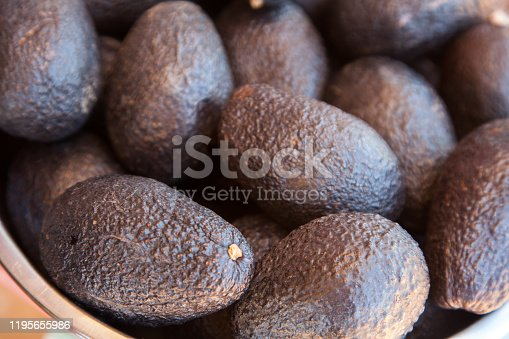 many avocados in a bowl