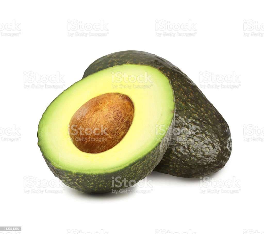 Avocados with pit royalty-free stock photo