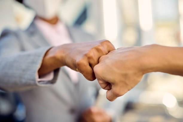 Avoiding handshakes during coronavirus epidemic! stock photo