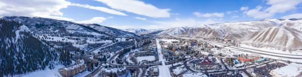 Avon Colorado USA Winter Panoramic View Ski Resort Town Snowy Mountain Peaks Avon Colorado USA Winter Panoramic View Ski Resort Town Snowy Mountain Peaks vail colorado stock pictures, royalty-free photos & images
