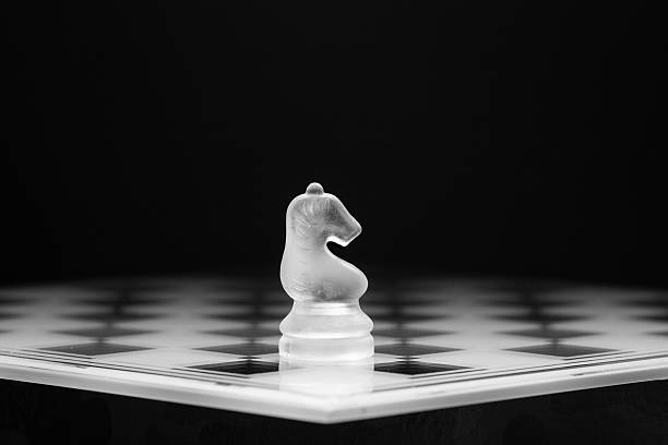 Awaiting pieces on a chess board abjure stock pictures, royalty-free photos & images