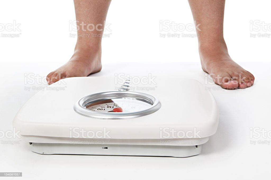 Awaiting the moment of truth! Bathroom scale stock photo