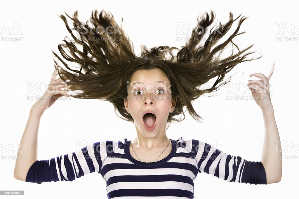 Awe teenage girl with flying hair and surprised expression royalty-free stock photo