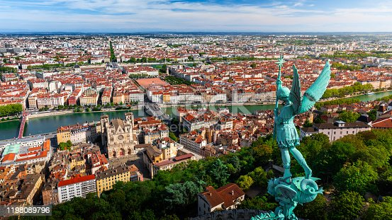 istock Awesome aerial view on Lyon French cityscape viewed from the roofs of Basilica Notre Dame de Fourviere with Archangel Michael statue overlooking the city 1198089796