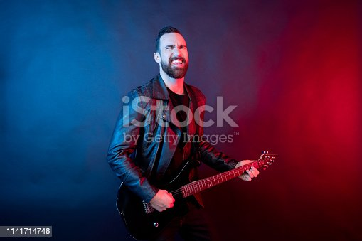 Awesome guitarist rocking out with electric guitar
