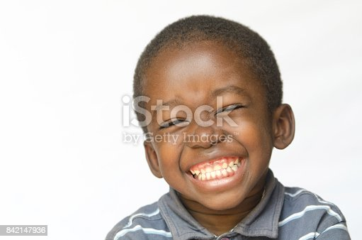 istock Awesome huge smile on black African ethnicity black boy child isolated on white Portrait 842147936