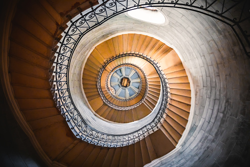 Awesome large spiral staircase seen from below inside one of the beautiful bell towers of the Basilica Notre Dame de Fourviere in Lyon French city
