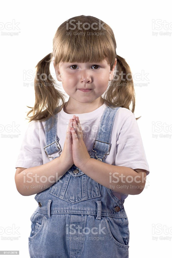 Awesome little girl praying for... stock photo