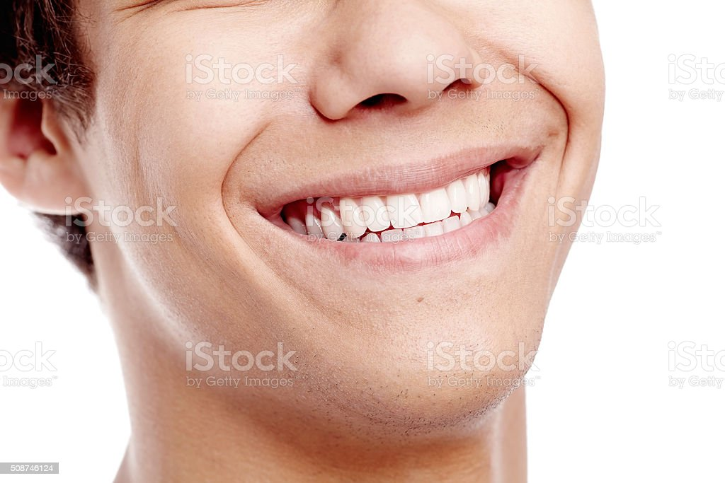 Awesome toothy smile closeup stock photo
