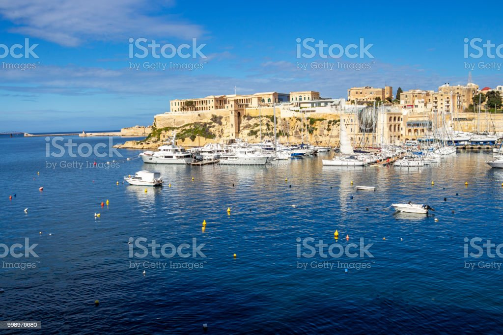 Awesome view of Kalkara Creek with the boat yard and Bighi Hospital in Kalkara as seen from Birgu, Malta stock photo