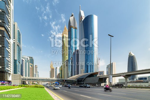 Dubai, United Arab Emirates - 2 November, 2018: Awesome view of Sheikh Zayed Road and Financial Centre Station of the Dubai Metro. Scenic skyscrapers are visible on blue sky background.