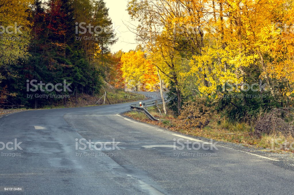 Awesome view of the asphalt road in the autumn scenery. stock photo