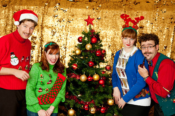 Awkward Christmas A group of 4 people with ugly Christmas sweatersMy Awkward Christmas Lightbox ugliness stock pictures, royalty-free photos & images