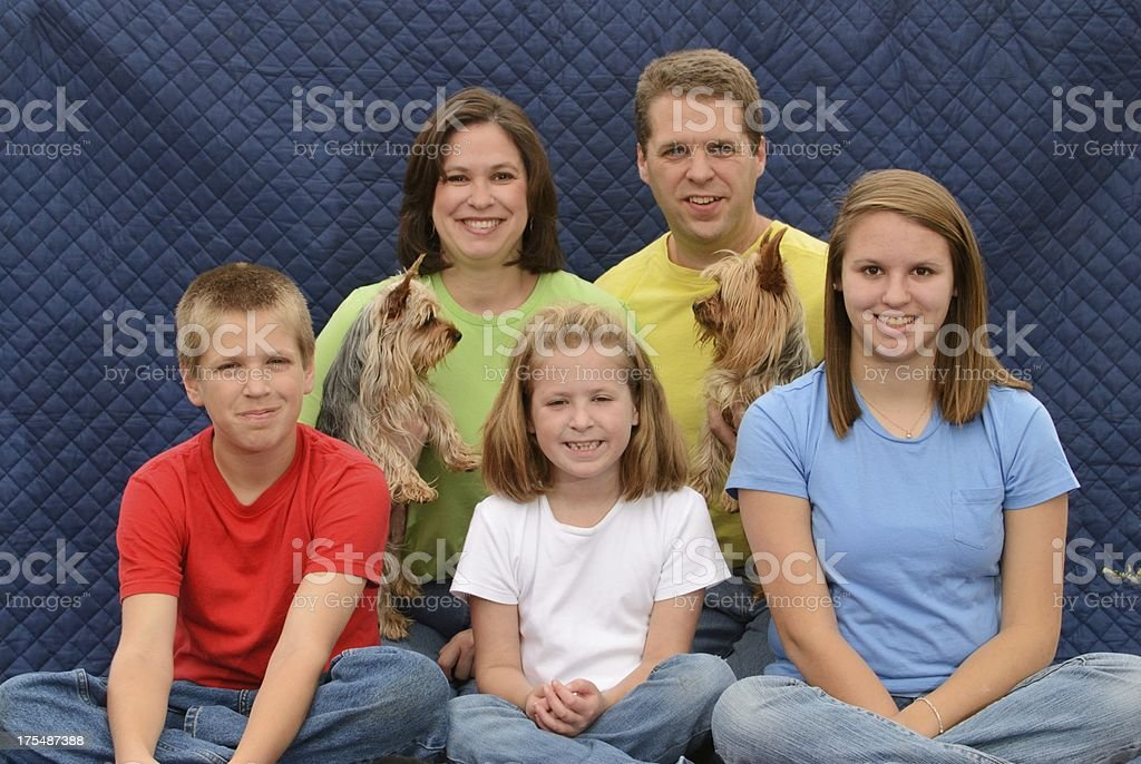 Awkward family posing for photo stock photo