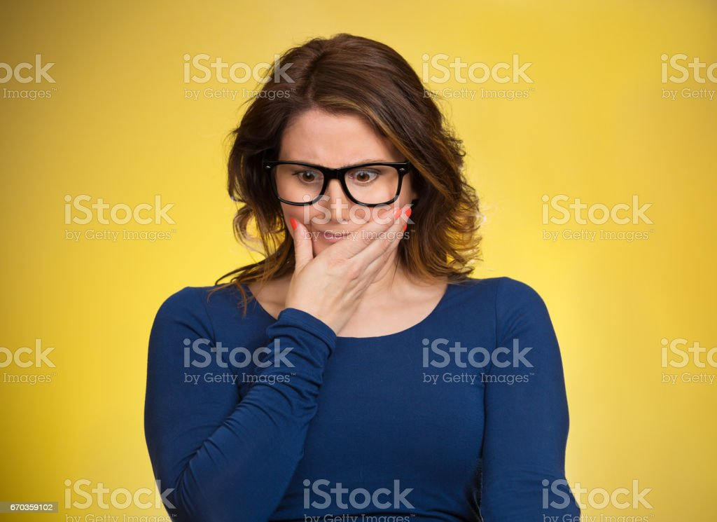 Awkward situation. Portrait embarrassed woman anxiously thinking how to get out of this, stock photo
