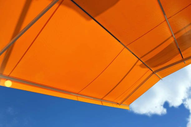 Awning against a blue sky stock photo