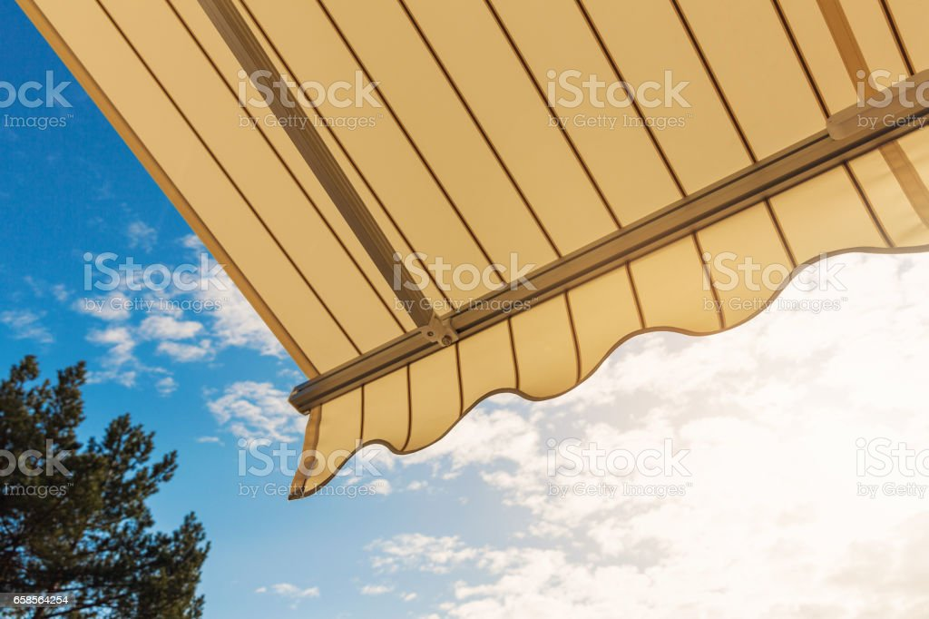 awning against blue sunny sky stock photo