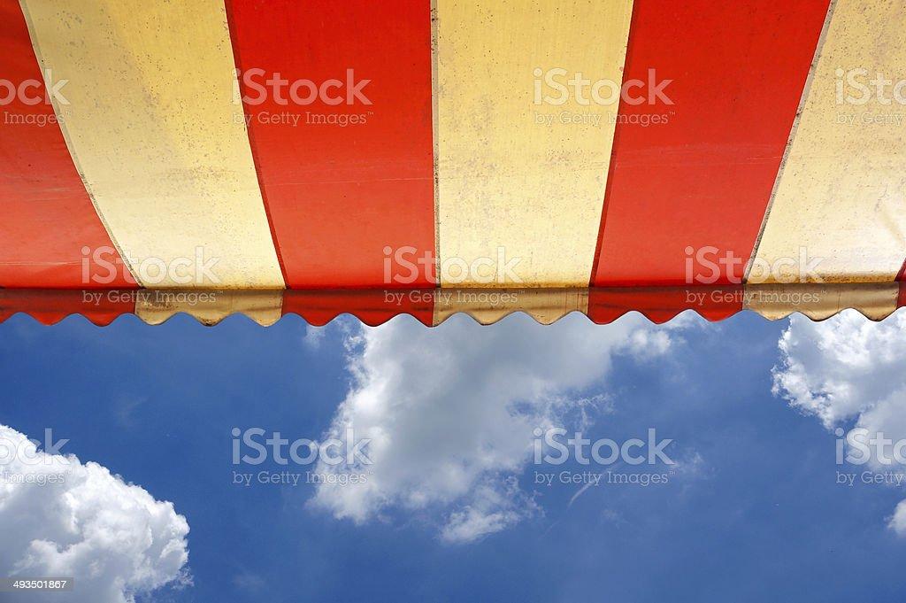 Awning over bright sunny blue sky stock photo