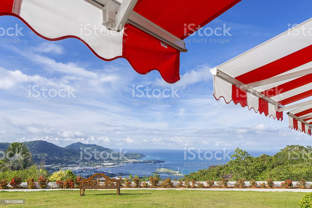 Awning over bright sunny blue sky with the view stock photo