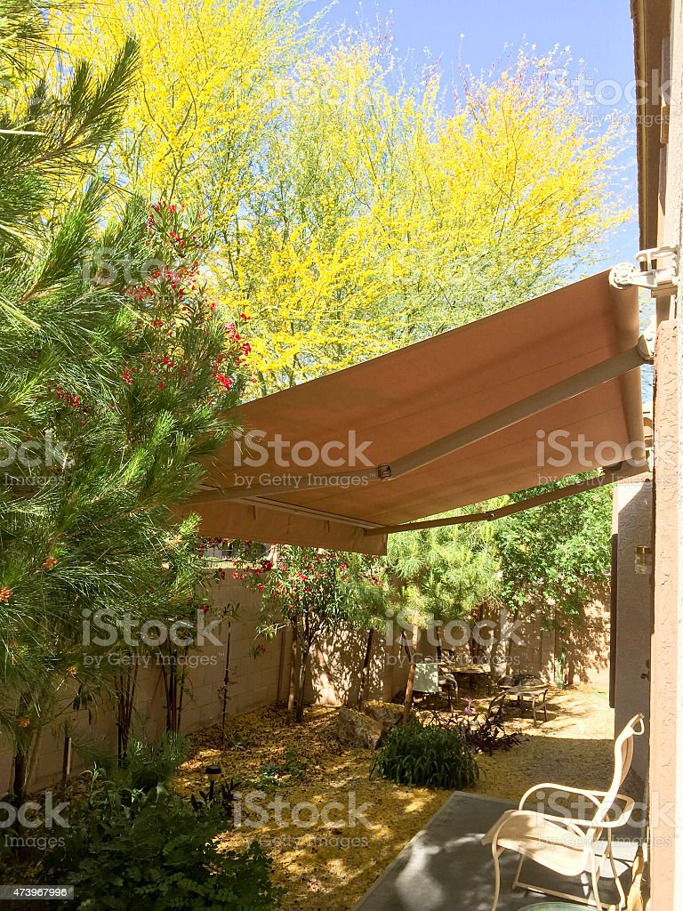 Awning retracted over a doorway stock photo