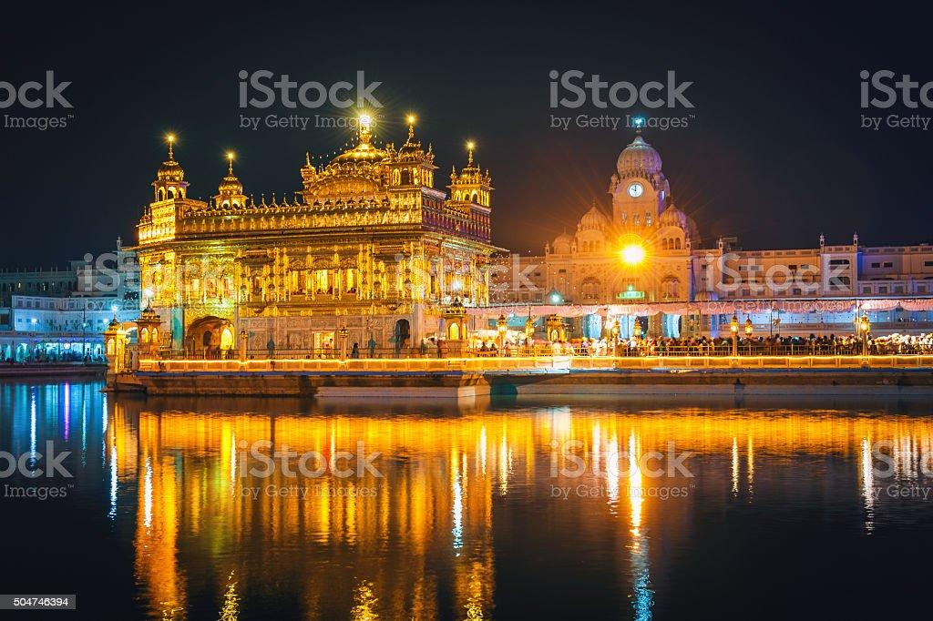 Awsome Sikh Golden Temple at Night Amritsar India stock photo