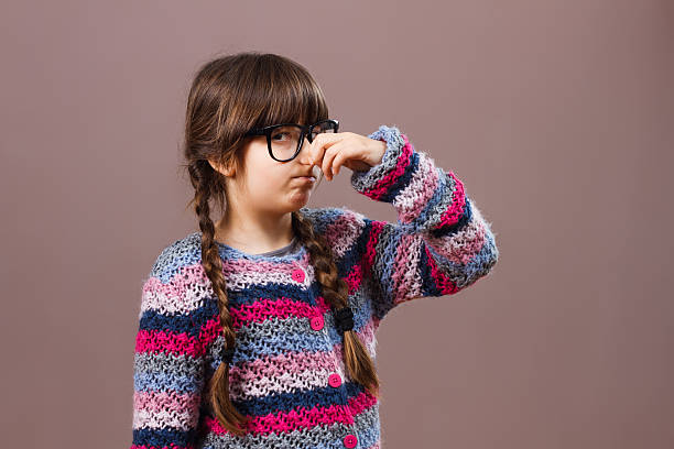 aww something smells so bad! - ugly girl stock photos and pictures