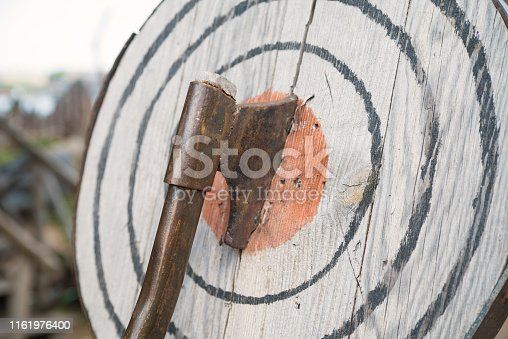 istock Ax in the target, entertainment throwing an ax 1161976400