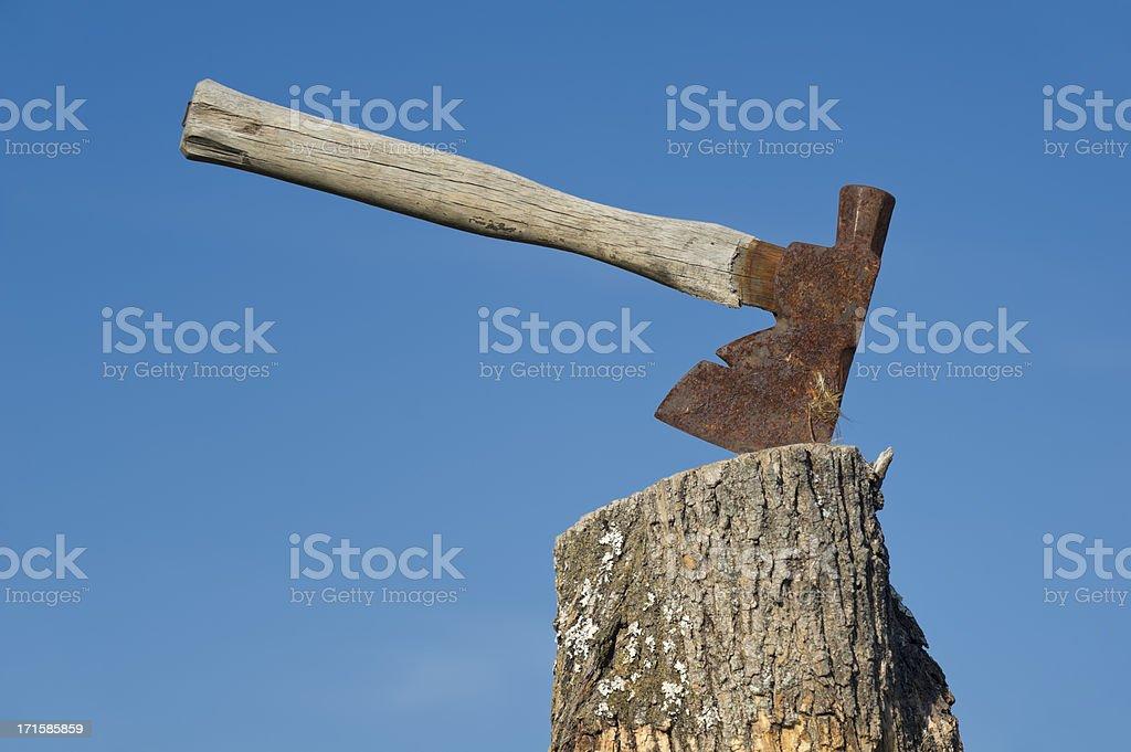 Ax Stuck into Stump Chopping Block stock photo