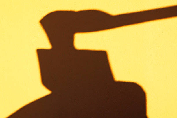 Axe and executioner, s block shadow stock photo