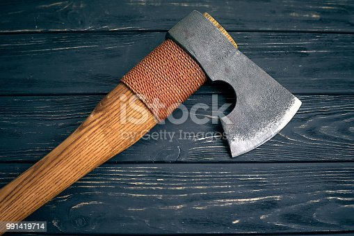 Axe lumberjack on wooden background. Blade. Close-up.