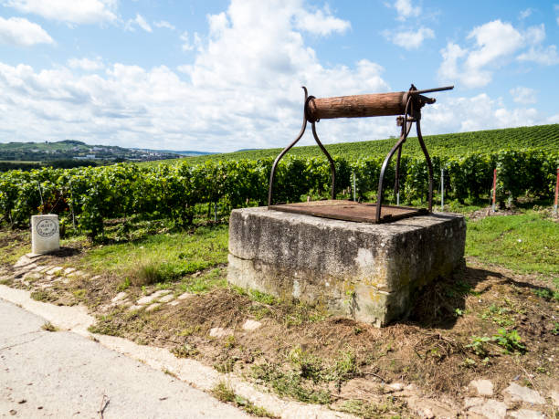 Ay, Champagne, France Ay, Champagne, France - 11 August 2014:  water well in the Hills covered with vineyards in the wine region of Champagne, France. Moet & Chandon moët & chandon stock pictures, royalty-free photos & images