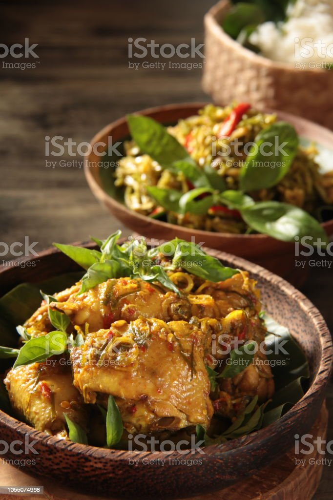 Ayam Tinoransak, the Traditional Minahasan Dish of Braised Chicken, Spices, and Basil Leaves stock photo