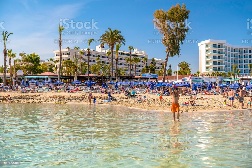 Ayia-Napa, Cyprus. People swimming and sunbathing on picturesque Nissi beach. stock photo