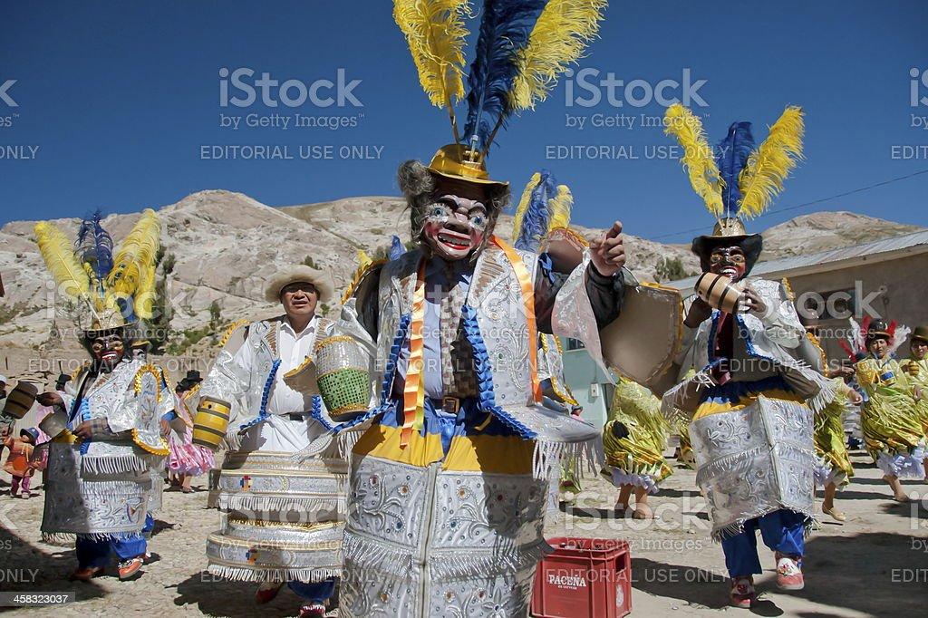 Aymara men in traditional mask dance at festival  Morenada. stock photo