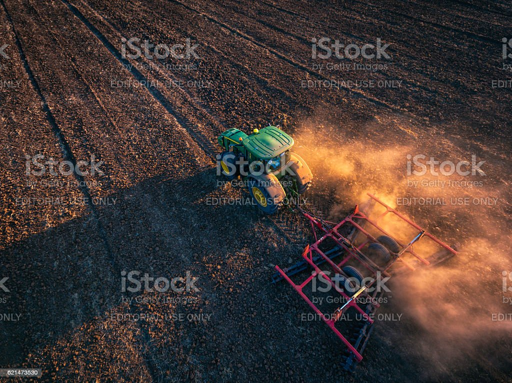 Aytos,Bulgaria - September 05,2016: John Deere tractor, field - foto de stock