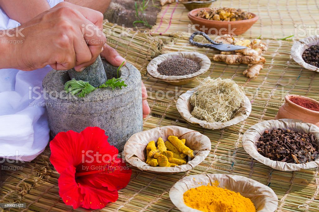 Ayurvedic Doctor A young man preparing Ayurvedic medicine in the traditional manner in India. 2015 Stock Photo