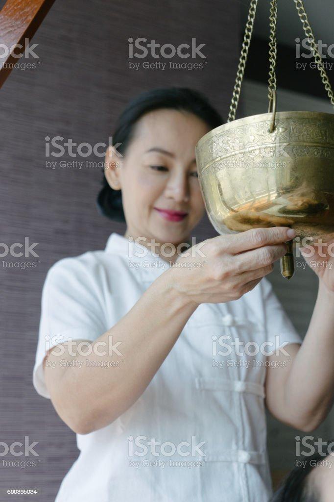 Ayurvedic practitioner preparing ayurveda spa massage stock photo