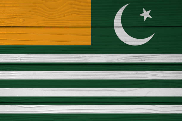 Azad Kashmir flag color painted on Fiber cement sheet wall background. stock photo