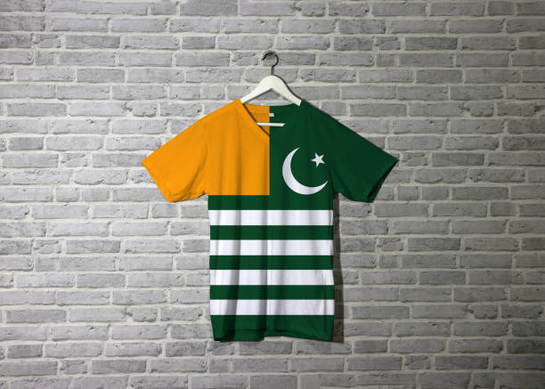 Azad Kashmir flag on shirt and hanging on the wall with brick pattern wallpaper. stock photo