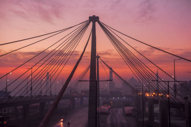 Azadi Bridge Lahore Early morning view of a newly built bridge in Lahore with Badshahi mosque in background. lahore pakistan stock pictures, royalty-free photos & images