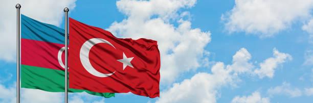 azerbaijan and turkey flag waving in the wind against white cloudy blue sky together. diplomacy concept, international relations. - azerbejdżan zdjęcia i obrazy z banku zdjęć
