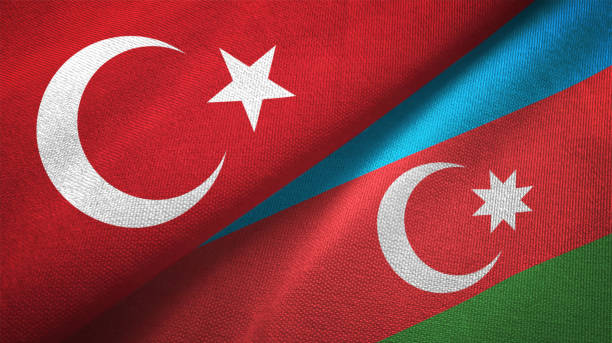 Azerbaijan and Turkey two flags together textile cloth fabric texture stock photo