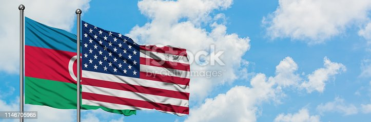 istock Azerbaijan and United States flag waving in the wind against white cloudy blue sky together. Diplomacy concept, international relations. 1146705965