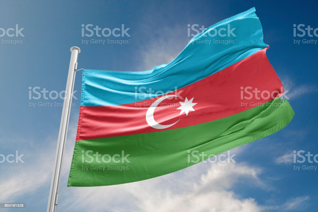 Azerbaijan Flag is Waving Against Blue Sky stock photo