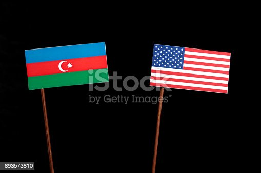 istock Azerbaijan flag with USA flag isolated on black background 693573810
